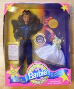 This doll never left her box. My mother was police officer so I identfied with Officer Barbie